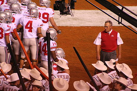 College Football Photos - Jim Tressel - Jim Tressel and team at halftime of the 2006 game at Texas.