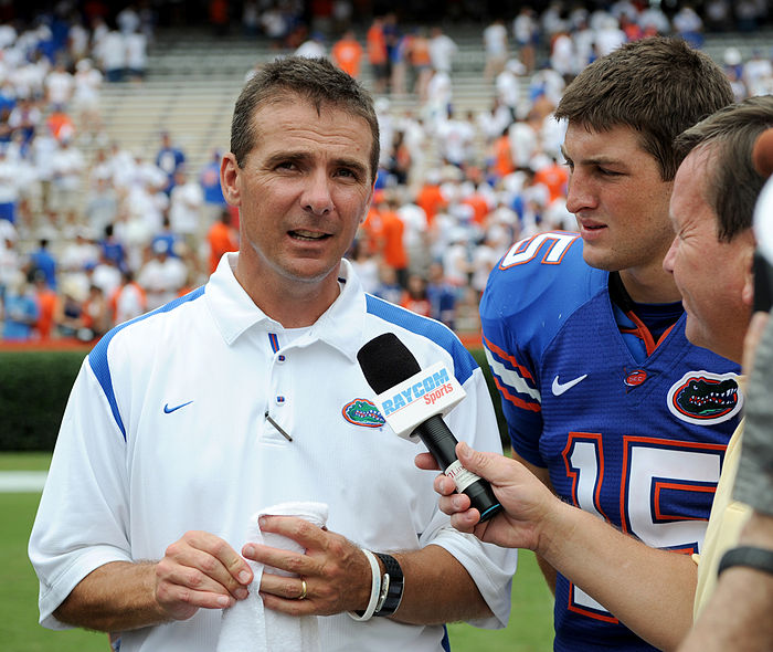 College Football Photos - Urban Meyer - Florida Gators coach Urban Meyer and quarterback Tim Tebow being interviewed following the Gators' August 30