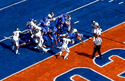 Football Photos - Doug Martin (Running Back) - Doug Martin (center) dives for a TD while playing for Boise State