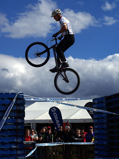 Sports Photos - Mountain Bike Racing - Trials events feature large jumps between artificial obstacles.