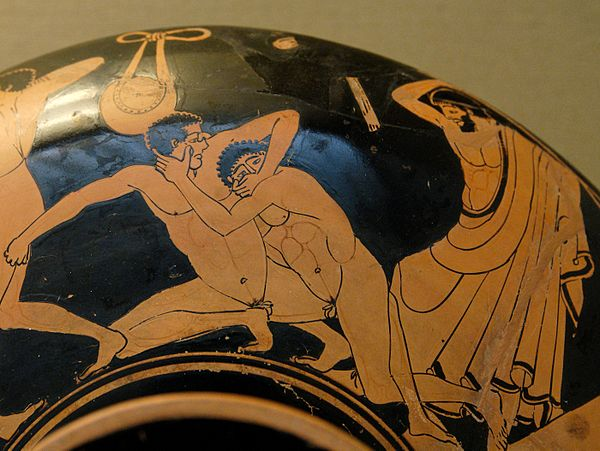Sports Photos - Pankration - Pankration scene: the pankriatiast on the right tries to gouge his opponent's eye; the umpire is about to strike him for this foul. Detail from an Ancient Greek Attic red-figure Kylix