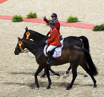 Horse Racing Photos - Show Jumping - 2008 Olympic equestrian jumping gold medalists Beezie Madden and Will Simpson