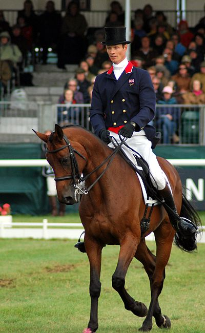 Horse Racing Photos - Three-Day Eventing - William Fox-Pitt riding shoulder-in in a dressage test at an event.