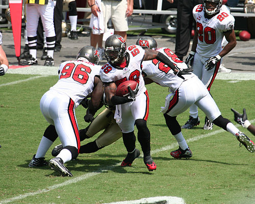 Football Photos - Cato June - June's first regular season interception for the Tampa Bay Buccaneers came on September 16