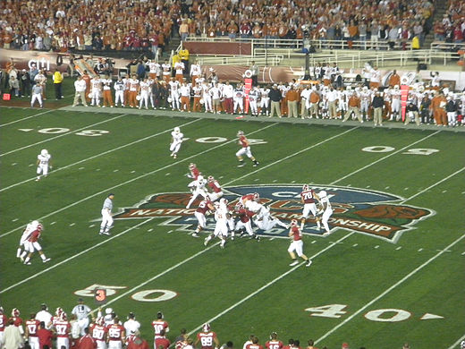 College Football Photos - BCS National Championship Game - 50-yard line action for the national championship in Pasadena California
