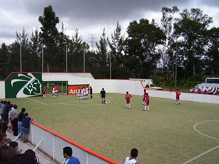 Soccer Photos - Indoor Soccer - An indoor soccer game played outdoors in Mexico. The referee has just awarded the red team a free kick.