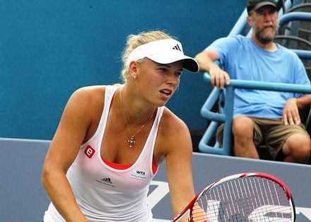 Tennis Photos - Caroline Wozniacki - Caroline Wozniacki serving in the New Haven Open.