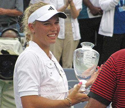 Tennis Photos - Caroline Wozniacki - Caroline Wozniacki accepting the winners trophy at the New Haven Open.