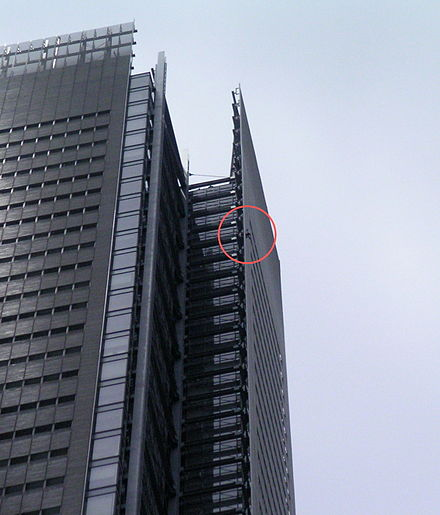 Sports Photos - Alain Robert - Alain Robert climbing the New York Times Building on June 5, 2008. Circle has been added to highlight Robert's location.