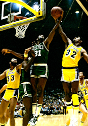 Basketball Photos - Magic Johnson - Johnson (No. 32) defending Cedric Maxwell in the 1985 NBA Finals.