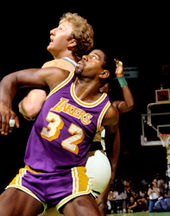 Basketball Photos - Magic Johnson - Johnson battling with Bird for rebounding position in Game 2 of the 1985 NBA Finals at Boston Garden.