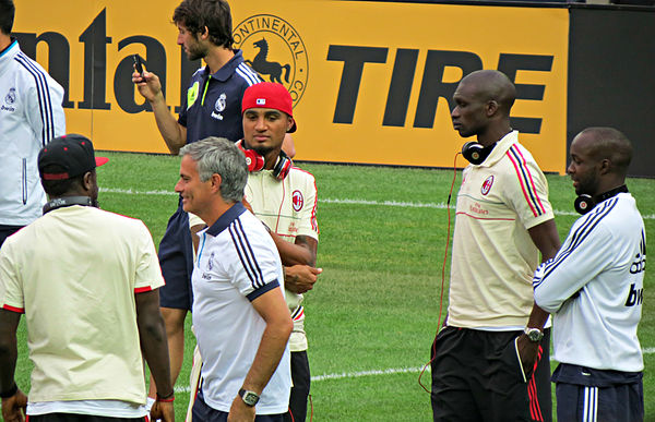 Soccer Photos - Jose Mourinho - Mourinho with Milan players prior to a pre-season match with Madrid.