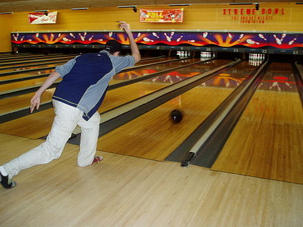 Sports Photos - Bowling - A ten-pin bowler releases the ball.