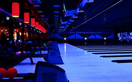 Sports Photos - Bowling - Bowling alley under UV-light.