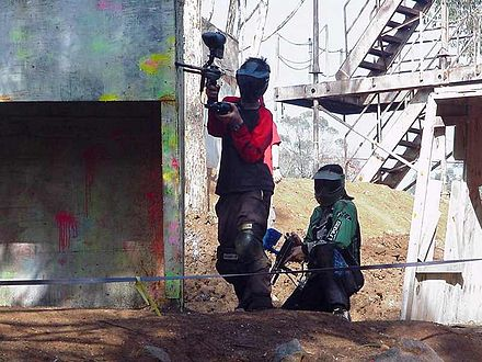 Sports Photos - Paintball - Paintball players in mid-game