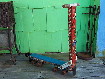 Sports Photos - Kick Scooter - Wooden scooter with a pair of roller skates