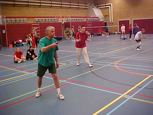 Sports Photos - Badminton - A men's doubles match. The blue lines are those for the badminton court. The other coloured lines denote uses for other sports