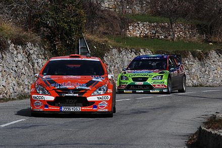 Motorsports Photos - World Rally Championship - Peugeot 307 WRC and Ford Focus RS WRC 07 on a road section during the 2008 Monte Carlo Rally.