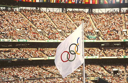 Olympics Photos - 1996 Summer Olympics - The Olympic flag waves at the 1996 games