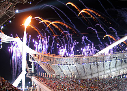 Olympics Photos - 2004 Summer Olympics - The Olympic Flame at the Opening Ceremony