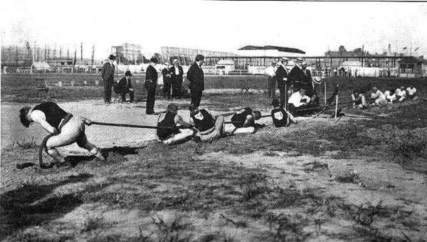 Olympics Photos - 1904 Summer Olympics - A tug-of-war competition at the 1904 Summer Olympics.