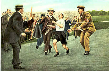 Olympics Photos - 1908 Summer Olympics - Dorando Pietri finishes the marathon.