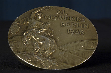 Olympics Photos - 1936 Summer Olympics - Front of John Woodruff's Gold Medal for winning the 800 metres.