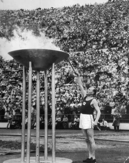 Olympics Photos - 1952 Summer Olympics - Paavo Nurmi and the Olympic Flame