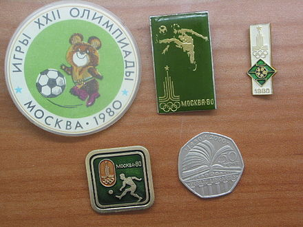Olympics Photos - 1980 Summer Olympics - Pins released by the USSR for the football event of the Olympics (with a British 50 pence coin for size comparison)