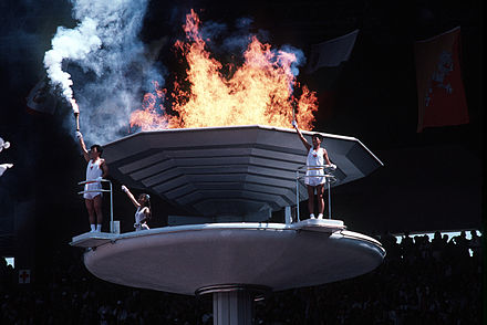 Olympics Photos - 1988 Summer Olympics - South Koreans stand by the cauldron of the 1988 Summer Olympics.