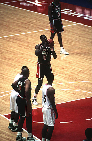 "Olympics Photos - 1992 Summer Olympics - The 1992 Summer Olympics allowed NBA players to participate in the basketball competition for the first time; here David Robinson shoots a free throw for the gold-medal winning United States ""Dream Team""."
