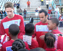 Soccer Photos - Clarence Goodson - Goodson signing autographs with Landon Donovan during an open training session at the 2010 FIFA World Cup