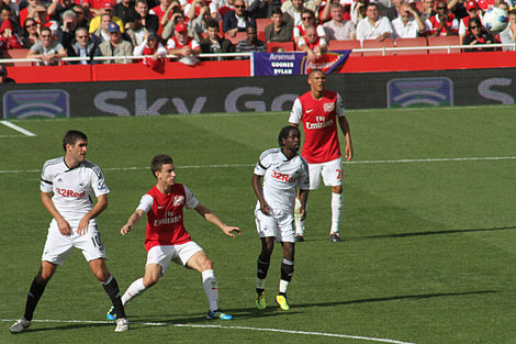 Soccer Photos - Laurent Koscielny - Koscielny playing for Arsenal on 10 September 2011 against Swansea City.