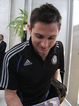 Soccer Photos - Frank Lampard - Lampard signing a match-day programme
