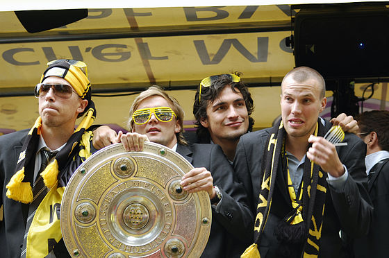 "Soccer Photos - Mats Hummels - Hummels (second from right) celebrates winning the Bundesliga with Borussia Dortmund in <a href=""/wiki/2010%E2%80%9311_Bundesliga"" title=""2"