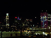 Baseball Photos - Philadelphia Phillies - The Phillies logo as it illuminated the Cira Center in October