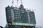 Baseball Photos - Chicago Cubs - Wrigley Field's famous manual scoreboard in center field