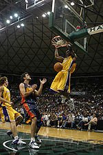 Basketball Photos - Kobe Bryant - Bryant dunks against Golden State Warriors in October 2005