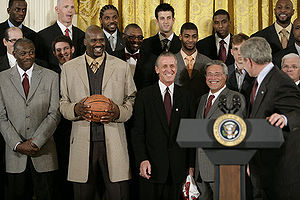 Basketball Photos - Shaquille O'Neal - O'Neal holding the championship ball when the NBA Champion Heat visited the White House